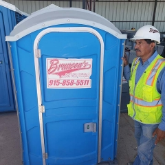 brunson's worker next to porta potty